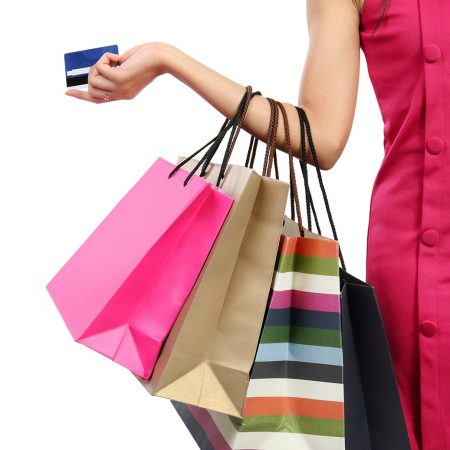 young-woman-with-shopping-bags-4-e1408941566529